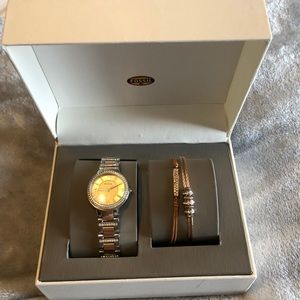 Women's Fossil boxed watch set.